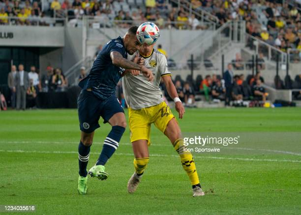 Alexander Callens of New York City FC heads the ball way from Miguel Berry of Columbus Crew during the game between New York City FC and Columbus...