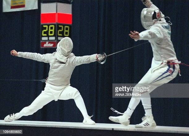 Alexander Chirchov of Russia scores a point against Gael Touya of France during the final of the men's sabre team competition at the World Fencing...