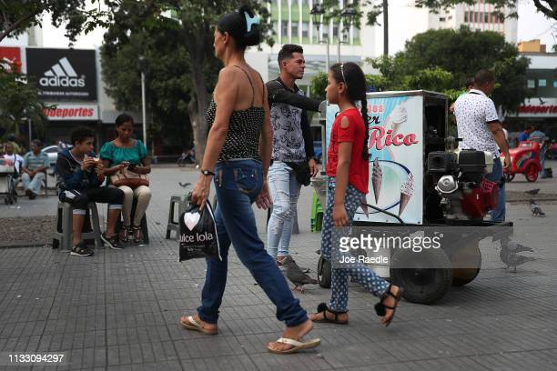 Alexander Colina who left Falcon Venezuela sells ice cream to customers in a city park on March 1 2019 in Cucuta Colombia Many Venezuelans have left...