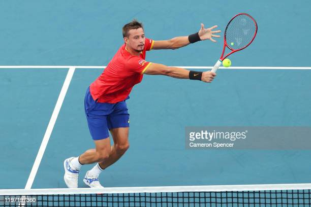 Alexander Cozbinov of Moldova plays a backhand during the Group C singles match between Steve Darcis of Belgium and Alexander Cozbinov of Moldova...