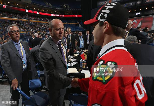 Alexander Debrincat visits with Stan Bowman at the Chicago Blackhawks draft table after Debrincat was selected 39th overall by the Chicago Blackhawks...