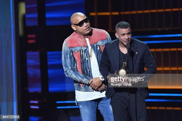 Alexander Delgado and Randy Malcom from Gente de Zona recieve an award onstage during Univision's 29th Edition of Premio Lo Nuestro A La Musica...