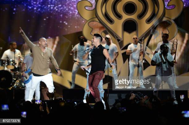 Alexander Delgado from Gente de Zona and Chyno Miranda perform onstage during the iHeartRadio Fiesta Latina Celebrating Our Heroes at American...