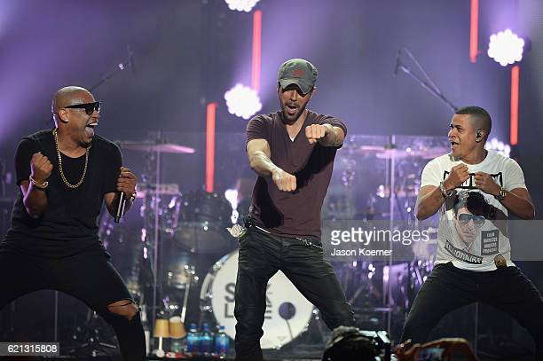 Alexander Delgado of the group Gente de Zona and Enrique Iglesias and Randy Malcom of Gende de Zona perform on stage at iHeartRadio Fiesta Latina at...