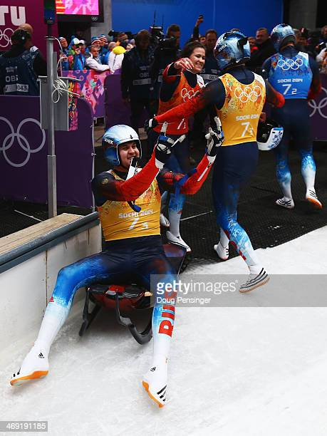 Alexander Denisyev Tatyana Ivanova Vladislav Antonov and Albert Demchenko of Russia celebrate taking the lead during the Luge Relay on Day 6 of the...