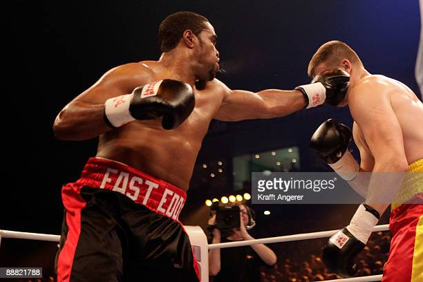 Alexander Dimitrenko of Ukraine takes a punch on Eddie Chambers of USA during the WBO Eliminator Heavyweight fight between Alexnder Dimitrenko of...