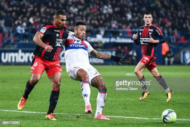 Alexander Djiku of Caen and Memphis Depay of Lyon during the Ligue 1 match between SM Caen and Olympique Lyonnais at Stade Michel D'Ornano on...