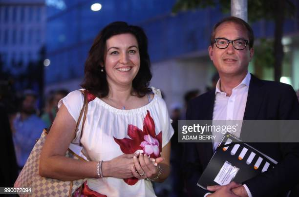 Alexander Dobrindt first deputy leader of the CDU/CSU group in the Bundestag poses with Dorothee Baer state minister for digitalization as they leave...