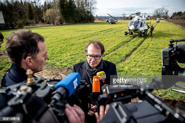Alexander Dobrindt German Minister of Transport arrives at the site where two trains collided headon several hours before in Bavaria on February 9...