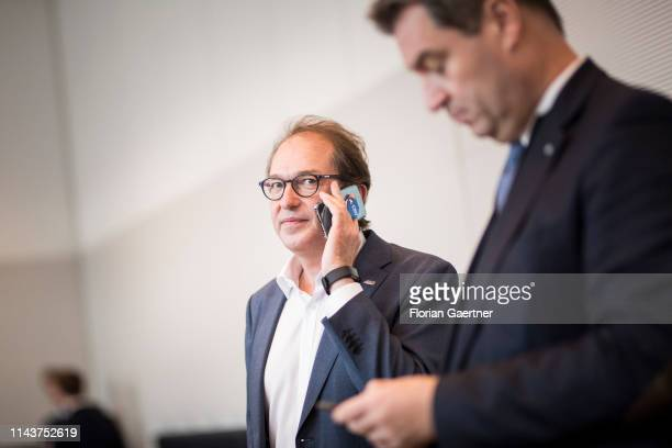 Alexander Dobrindt Parliamentary group leader of the CSU and Markus Soeder Prime Minister of the German State of Bavaria are pictured before the...