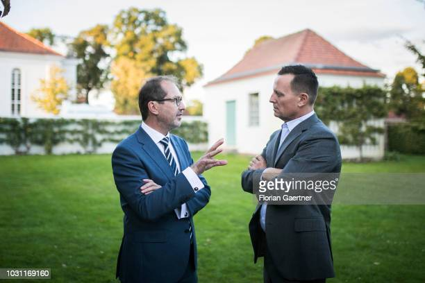 Alexander Dobrindt Parliamentary group leader of the CSU talks with Richard Grenell Ambassador of the USA in Germany at the summer meeting of the CSU...