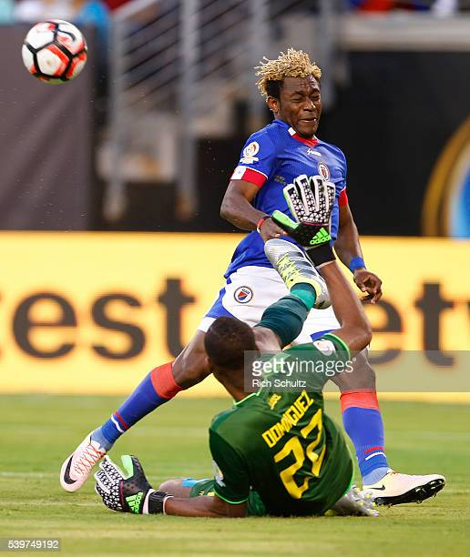 Alexander Dominguez goakeeper of Ecuador deflects a shot by Sony Norde of Haiti during a group B match between Ecuador and Haiti at MetLife Stadium...