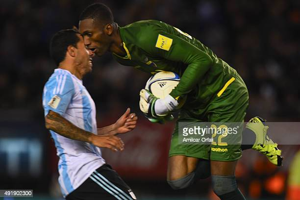 Alexander Dominguez goalkeeper of Ecuador catches the ball against Carlos Tevez of Argentina during a match between Argentina and Ecuador as part of...