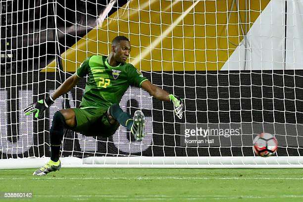 Alexander Dominguez goalkeeper of Ecuador fails to stop a shot by Christian Cueva of Peru during a group B match between Ecuador and Peru as part of...