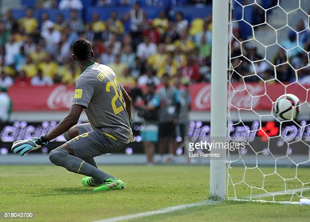 Alexander Dominguez goalkeeper of Ecuador fails to stop the goal scored by Carlos Bacca of Colombia during a match between Colombia and Ecuador as...