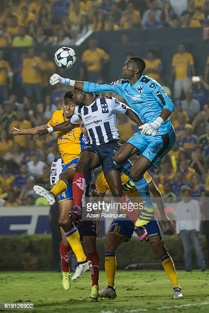 Alexander Dominguez goalkeeper of Monterrey rejects the ball during the 15th round match between Tigres UANL and Monterrey as part of the Torneo...