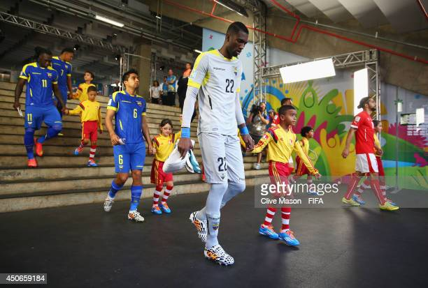 Alexander Dominguez of Ecuador and the team make their way out to the pitch prior to the 2014 FIFA World Cup Brazil Group E match between Switzerland...