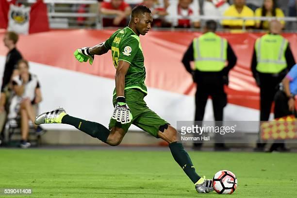 Alexander Dominguez of Ecuador kicks the ball up field during a group B match between Ecuador and Peru at University of Phoenix Stadium as part of...