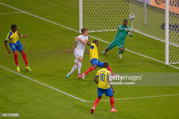 Alexander Dominguez of Ecuador makes a save on a shot by Antoine Griezmann of France during the 2014 FIFA World Cup Brazil Group E match between...