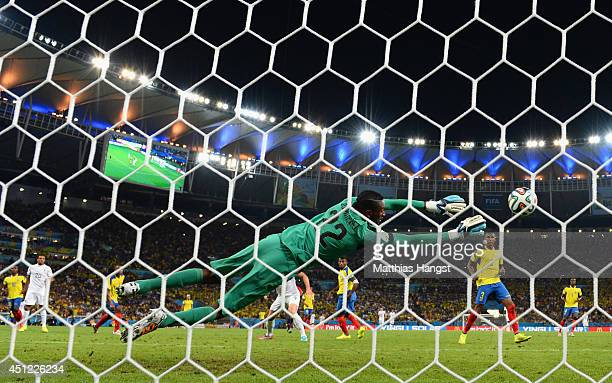 Alexander Dominguez of Ecuador makes a save on a shot by Loic Remy of France during the 2014 FIFA World Cup Brazil Group E match between Ecuador and...