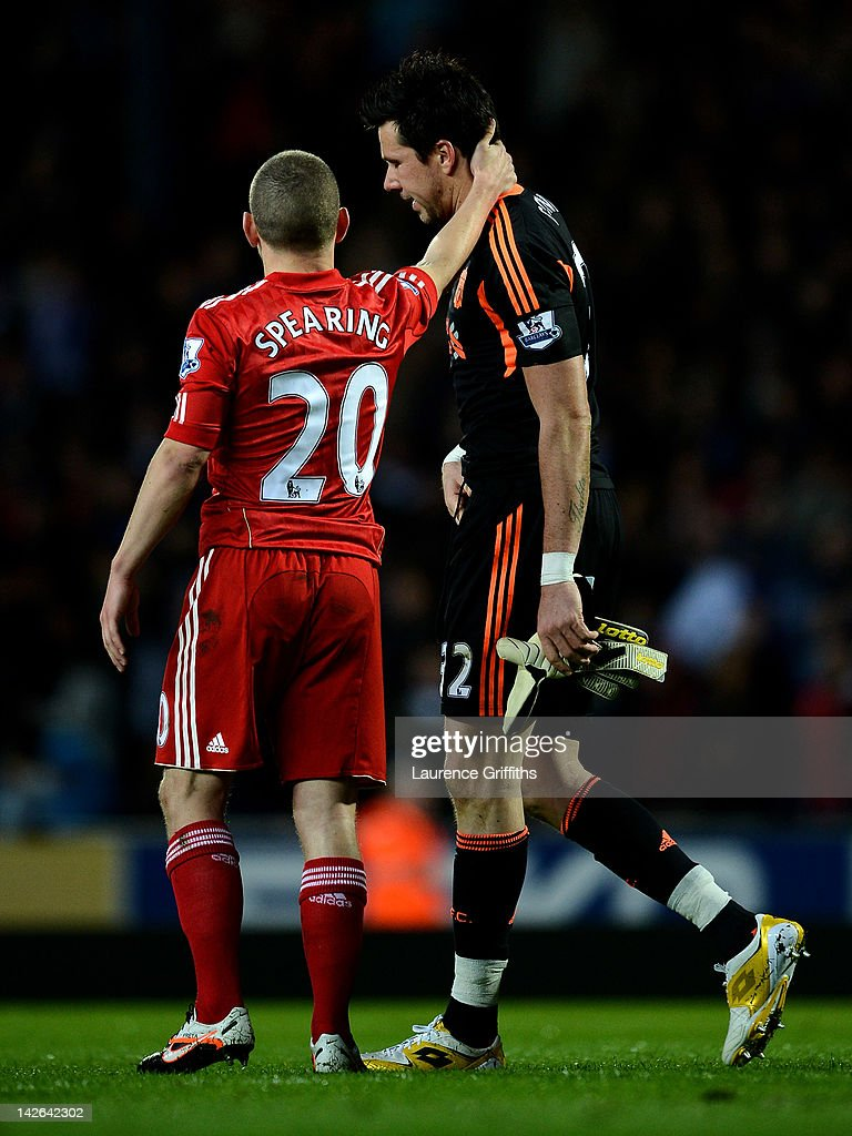 Alexander Doni of Liverpool is consoled by team mate Jay Spearing after being sent off during the Barclays Premier League match between Blackburn Rovers and Liverpool at Ewood park on April 10, 2012 in Blackburn, England.