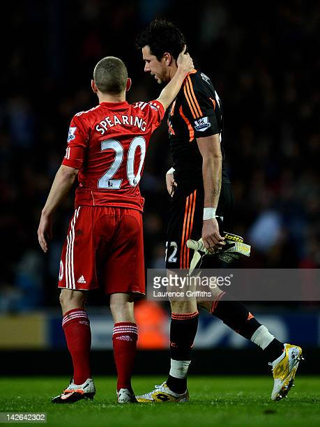 Alexander Doni of Liverpool is consoled by team mate Jay Spearing after being sent off during the Barclays Premier League match between Blackburn...
