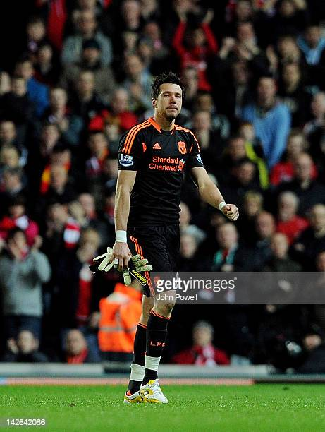 Alexander Doni of Liverpool shows his dejection after receiving a red card and conceding a penalty for a foul on Junior Hoilett of Blackburn Rovers...