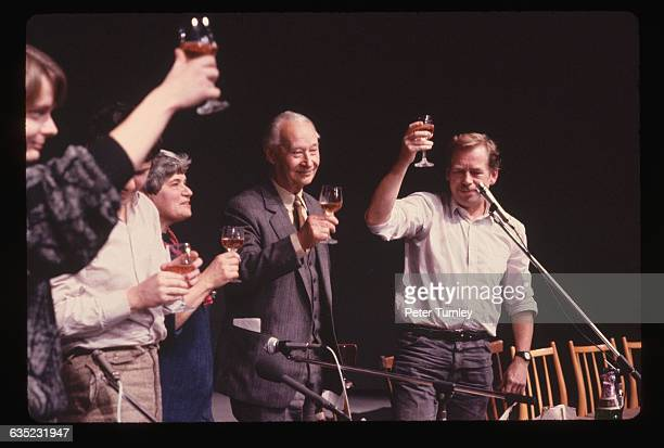 Alexander Dubcek and Vaclav Havel are joined by other Czechoslovakian politicians as they toast the resignation of the Communist politburo in...
