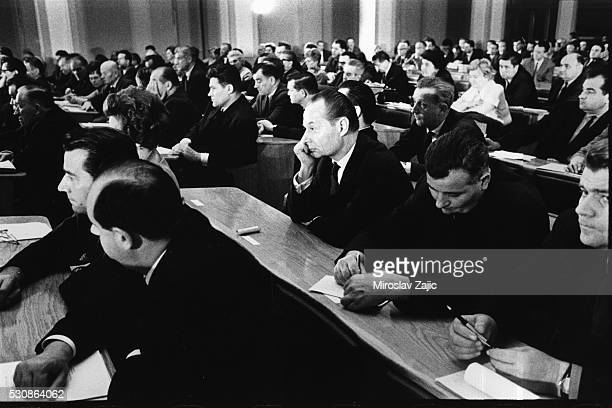 Alexander Dubcek sits in the center during a parliament session to ratify the Moscow Protocol treaty with the USSR