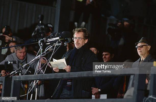 Alexander Dubcek watches as Vaclav Havel speaks to a crowd during the Velvet Revolution in Prague Czechoslovakia