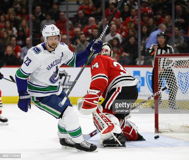 Alexander Edler of the Vancouver Canucks celebrates after scoring a first period goal against JF Berube of the Chicago Blackhawks at the United...