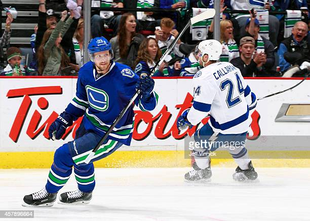 Alexander Edler of the Vancouver Canucks celebrates his goal during their NHL game against theTampa Bay Lightning at Rogers Arena October 18 2014 in...