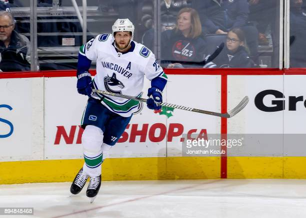 Alexander Edler of the Vancouver Canucks follows the play up the ice during third period action against the Winnipeg Jets at the Bell MTS Place on...