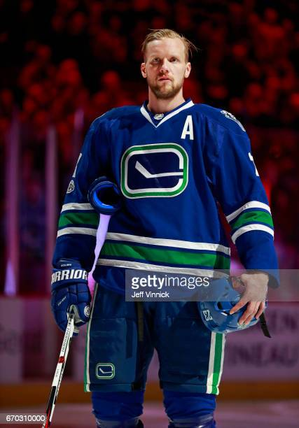 Alexander Edler of the Vancouver Canucks listens to the national anthem during their NHL game against the San Jose Sharks at Rogers Arena April 2...
