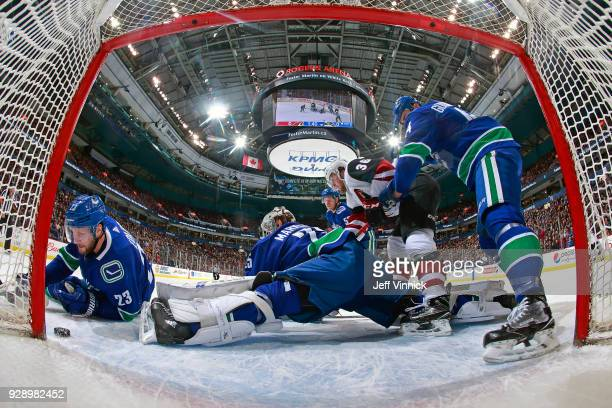Alexander Edler of the Vancouver Canucks looks on as Clayton Keller of the Arizona Coyotes scores during their NHL game at Rogers Arena March 7 2018...