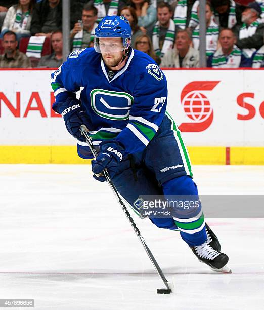 Alexander Edler of the Vancouver Canucks skates up ice with the puck during their NHL game against theTampa Bay Lightning at Rogers Arena October 18...
