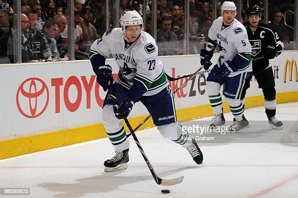 Alexander Edler of the Vancouver Canucks skates with the puck against the Los Angeles Kings in Game Three of the Western Conference Quarterfinals...