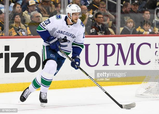 Alexander Edler of the Vancouver Canucks skates with the puck in the second period during the game against the Pittsburgh Penguins at PPG PAINTS...