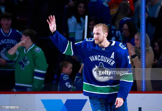 Alexander Edler of the Vancouver Canucks waves to fans during their NHL game against the Los Angeles Kings at Rogers Arena March 28 2019 in Vancouver...