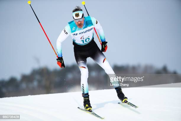Alexander Ehler of Germany competes in the Men's Cross Country 20km Free Standing event at Alpensia Biathlon Centre during day three of the...