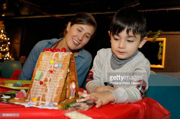 Alexander Eliopoulos shows off his gingerbread house he decorated to Community Engagement Coordinator Educator Brittany Liscord Sunday Dec 3 2017 at...