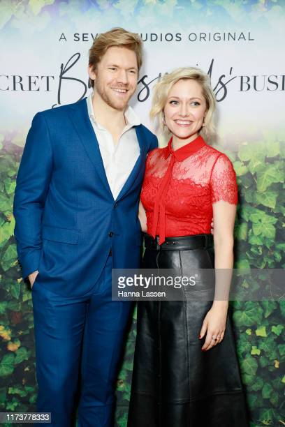 Alexander England and Georgina Haig attend preview screening of Secret Bridesmaids' Business at Palace Verona on September 11 2019 in Sydney Australia