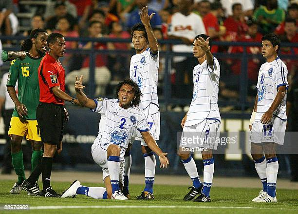 Alexander Escobar of El Salvador along with teammates protests a hard tackle by Omar Cummings of Jamaica in Group A Pool Play during the 2009...
