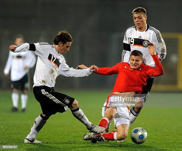 Alexander Esswein and Fabian Becker of Germany battle for the ball with Juergen Prutsch of Austria during the U20 International Friendly match...