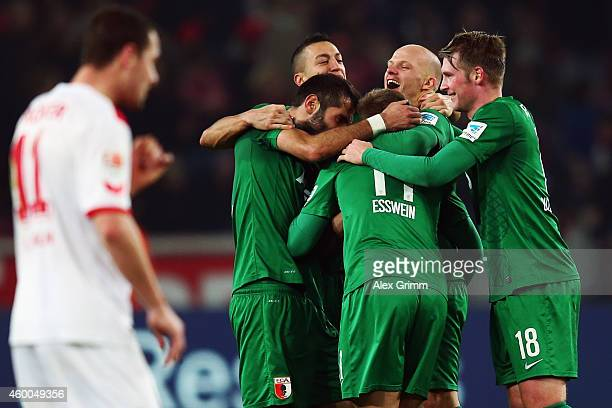 Alexander Esswein and team mates of Augsburg celebrate after the Bundesliga match between 1 FC Koeln and FC Augsburg at RheinEnergieStadion on...