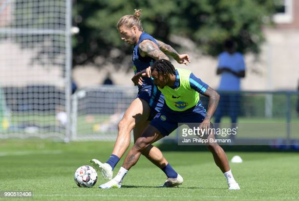 Alexander Esswein and Valentino Lazaro of Hertha BSC fight for the ball during a training session at the Schenkendorfplatz on July 3 2018 in Berlin...