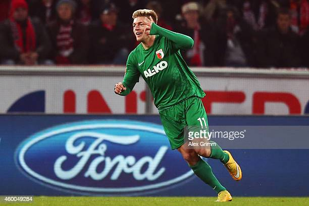 Alexander Esswein of Augsburg celebrates his team's second goal during the Bundesliga match between 1. FC Koeln and FC Augsburg at...