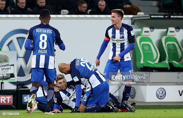 Alexander Esswein of Berlin celebrates after scoring his team's second goal with Salomon Kalou John Anthony Brooks and Sebastian Langkamp of Berlin...