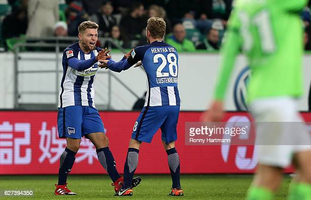 Alexander Esswein of Berlin celebrates after scoring his team's second goal with Fabian Lustenberger of Berlin during the Bundesliga match between...