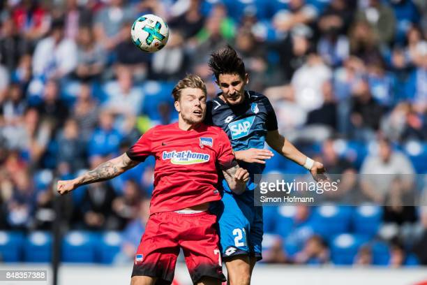 Alexander Esswein of Berlin jumps for a header Benjamin Huebner of Hoffenheim during the Bundesliga match between TSG 1899 Hoffenheim and Hertha BSC...